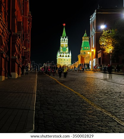 Night view of the Red Square, Spasskaya Tower of the Moscow Kremlin, pavement from a cobblestone - stock photo