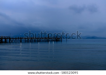 night view of the sea. mountains and sun - stock photo