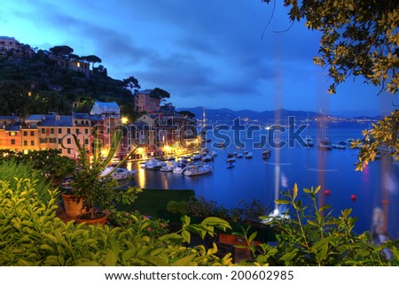 Night view of the small resort town of Portofino in Liguria province of Italy. Portofino town is located on the tip of a peninsula bearing the same name. - stock photo