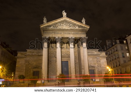 Night view of the south facade of the Church Notre-Dame-de-Lorette. It is a neoclassical church in the 9th arrondissement of Paris, France. - stock photo