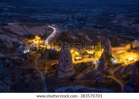Night view of the Uchisar town. The cave city in Cappadocia. Turkey - stock photo