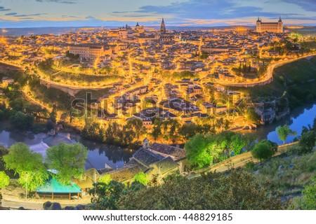 Night view of Toledo cityscape and Tagus River from the hill, Castilla la Mancha, Spain. - stock photo
