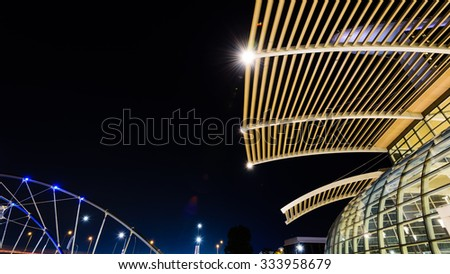 Night view of top structure of modern glass roof architecture ceiling buildings in Singapore with lens flare effect. Abstract modern background. Panoramic style - stock photo