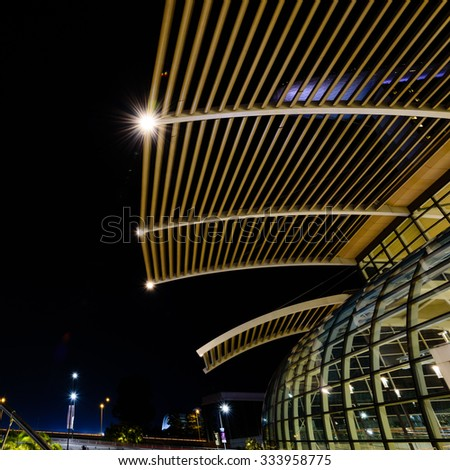 Night view of top structure of modern glass roof architecture ceiling buildings in Singapore with lens flare effect. Abstract modern background - stock photo