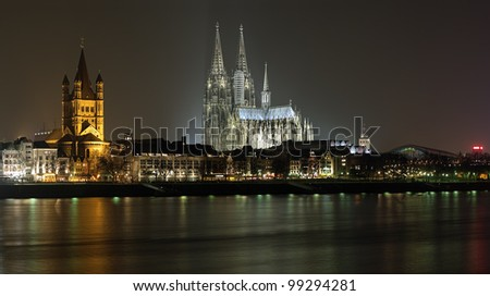 Night view on Cologne Cathedral and Great St. Martin Church, Cologne, Germany