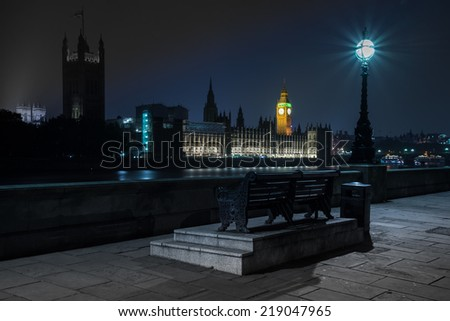 Night view on London landmarks Big Ben Clock and Parliament House over river Thames - stock photo