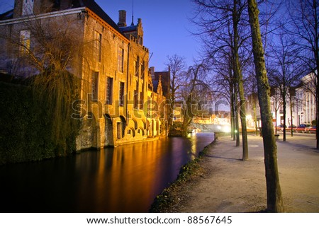 Night view on Medieval buildings on canal in Bruges, Belgium - stock photo