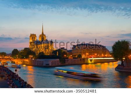 Night view on Notre Dame de Paris and the Sena river - stock photo