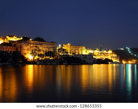 night view on palace and lake in Udaipur India - stock photo