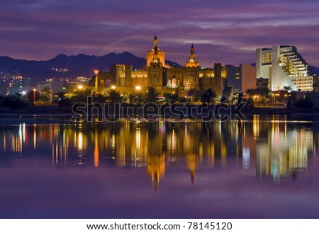 Night view on resort hotels and beautiful reflections in marine lagoon of Eilat city, Israel - stock photo