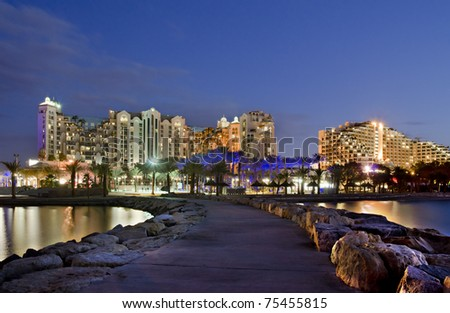 Night view on resort hotels and decorative illuminations on the northern beach of Eilat city, Israel - stock photo