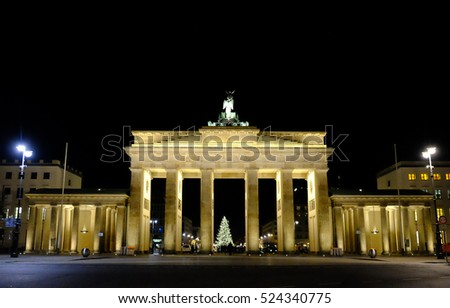 Night view on the famous illuminated Brandenburg Gate and Christmas tree. Berlin, Germany - 27.11.2016.