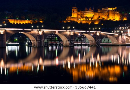 Night view on the Old bridge and ruined castle in Heidelberg, Germany - stock photo