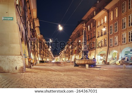night view on the shopping alley Kramgasse at Bern, Switzerland