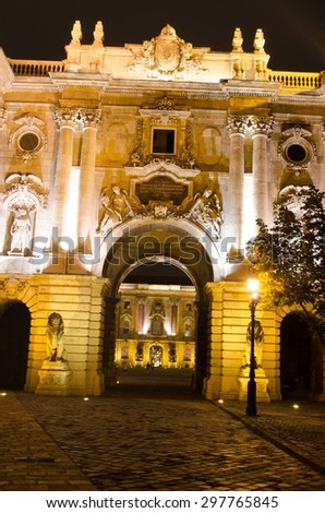 Night view over illuminated gate leading to the second courtyard in Buda castle complex situated in hungarian capital budapest. - stock photo