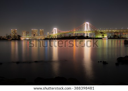 Night view, Rainbow Bridge with mirror reflection in Tokyo Bay, Tokyo City Skyline background from Odaiba at night, Japan - stock photo