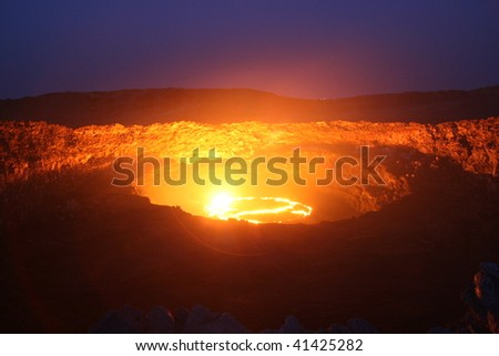 Night view to the  lava lake  of the erta ale volccano in Ethiopia - stock photo