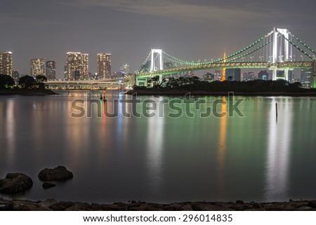 Night view Tokyo Skyline with Rainbow bridge, Long exposure, silk water - stock photo