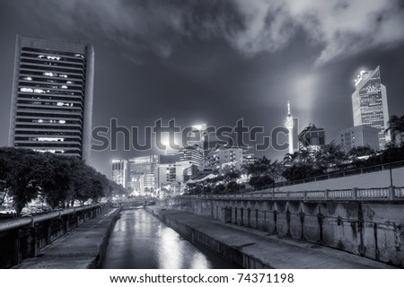 Night view with modern buildings and river in Kuala Lumpur, Malaysia, Asia. - stock photo