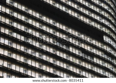 night  windows pattern of giant skyscraper building, Tokyo Japan - stock photo