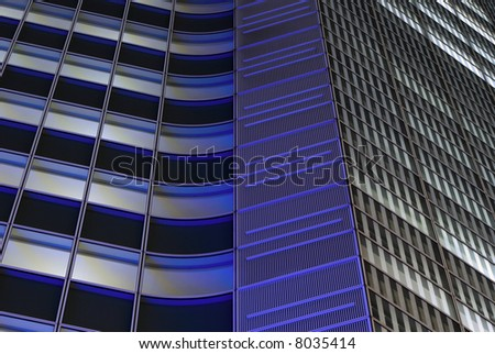 night windows rows and wall pattern of giant skyscraper building, Tokyo Japan - stock photo