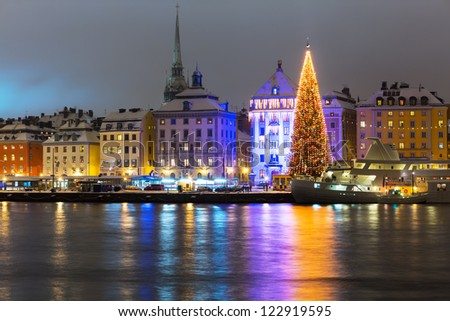 Night winter scenery of the Old Town (Gamla Stan) with Christmas Tree in Stockholm, Sweden - stock photo