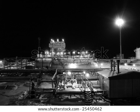 Night work on a oil and gas refinery center. Black and white photo - stock photo