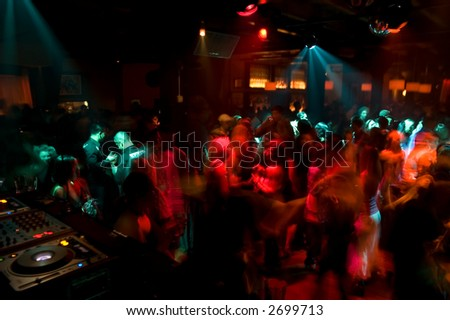 Nightclub dance crowd in motion - stock photo