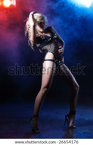 nightclub go-go style dancer is posing