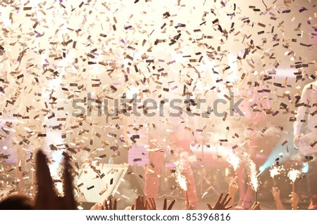Nightclub lights and confetti party background - stock photo