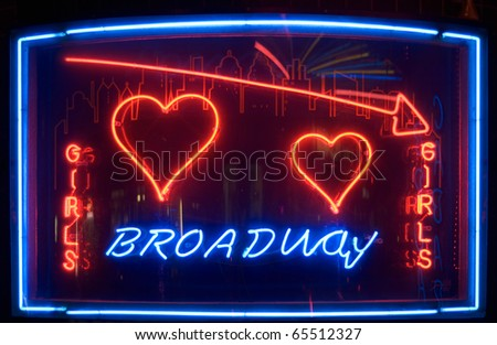 Nightclub Neon Sign with Broadway and Girls Text - stock photo