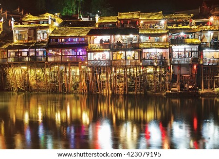 Nightlife in old city Fenghuang, China. - stock photo