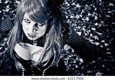 Nightmare scene with sexy girl in black dress looking up - stock photo