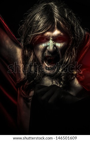 Nightmare, Young Vampire with black coat and long hair, nude - stock photo