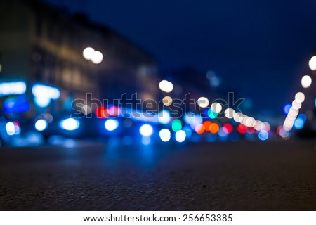 Nights lights of the big city, close up view from asphalt level. In blue tones - stock photo