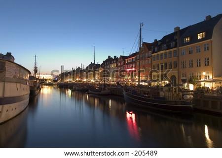 Nightshot at Nyhavn harbour, Copehagen - stock photo