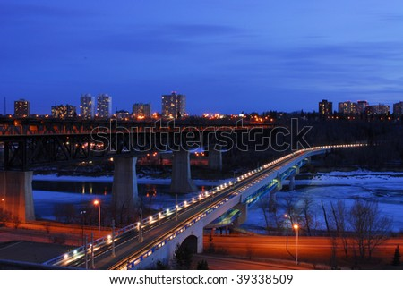 Nightshot of low and high bridges and the still frozen north saskatchewan river, edmonton, alberta, canada - stock photo
