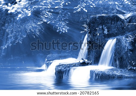 Nighttime Falls, with Moonlight on wide angle long exposure capture of Waterfalls. - stock photo