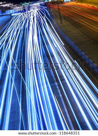 Nighttime highway in the city center. Long exposure - stock photo