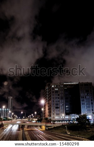 Nighttime highway traffic in downtown Chicago - stock photo