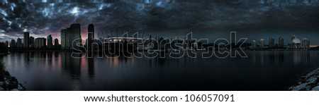 Nighttime rendition of Vancouver, British Columbia as viewed from False Creek. - stock photo
