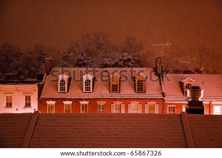 Nighttime Snow Georgetown Apartments Buildings Rooftops in Snowstorm at Night Washington DC - stock photo