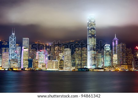 Nighttime view of Hong Kong skyline over Victoria harbor