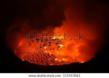 Nighttime view of lava lake in pit crater, Nyiragongo Volcano, Democratic Republic Congo - stock photo