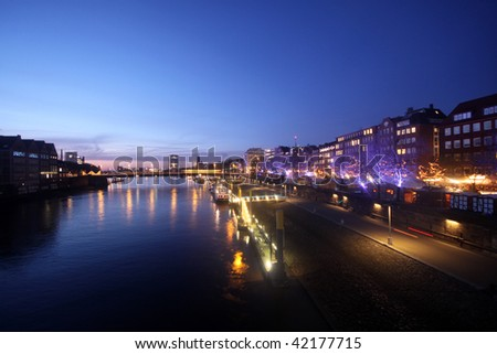 Nightview of Schlachte boulevard in Bremen with christmas market during sunset