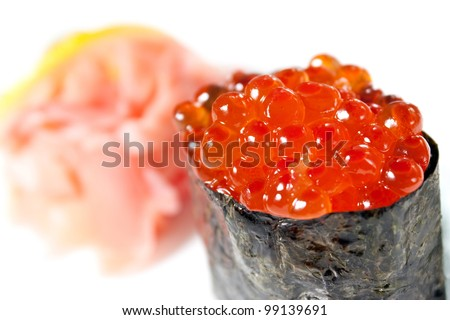 Nigiri Sushi with salmon roe, nori and ginger close-up - stock photo