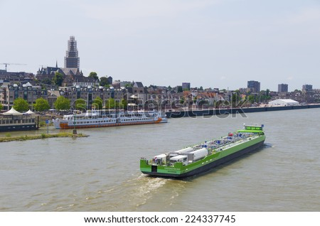 NIJMEGEN, NETHERLANDS - JULY 20, 2014: Liquid natural gas powered tanker on the Waal river. LNG Green Stream came into service in early 2013 as the first gasoil free tanker. - stock photo