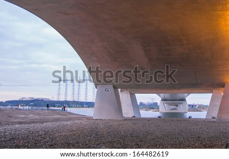"Nijmegen, Netherlands - November 23, 2013:  Under the new bridge ""De Oversteek"". It is the place where 48 soldiers died in the second world war when they crossed the river."