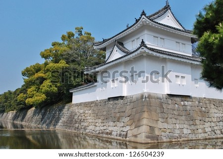 Nijo Castle in Kyoto, Japan is surrounded by rock walls and a deep moat. - stock photo