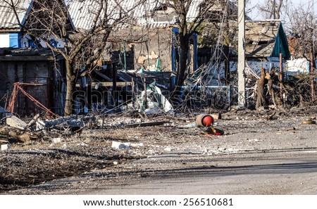 NIKISINO, UKRAINE - Feb 27, 2015: Ruined house. Village Nikishino located 20 km from Debaltseve, Ukrainian military was abandoned three days ago. Separatist forces attacked it for several days.  - stock photo